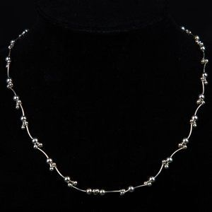 Vintage Dainty Articulated Silver toned chain neck